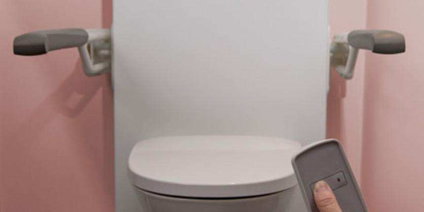 Sähköisesti korkeussäädettävä wc-istuin.